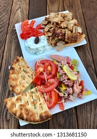 Dish of freshly made Gyros and Octopus salad, healthy and colorful Greek food