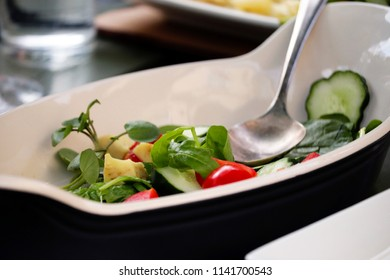 Dish of green salad.