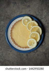 dish of lemon tart on rustic background