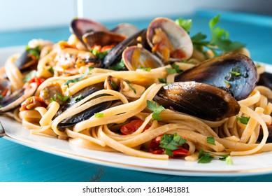 Dish of linguine allo scoglio, typical italian pasta with seafood sauce, Mediterranean Cuisine