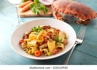 Dish of mezze maniche pasta with crab sauce, mediterranean food