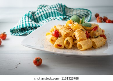 Dish of mezze maniche pasta with ricotta sauce and cherry tomatoes, Mediterranean food