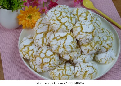 Dish with Moroccan festive homemade coconut cookies close up, GHRIBA TSMIDA.