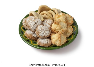 Dish with Moroccan homemade cookies on white background