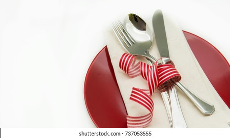 Dish with napkin and cutlery on white background