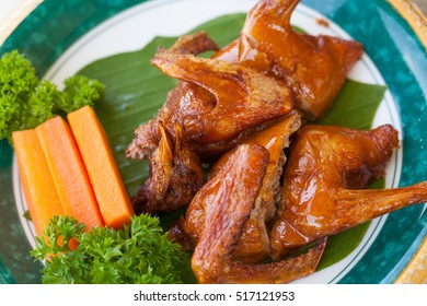 A dish of Nice oily brown color of Fried pigeon put on a nice decorated plate in Cantonese restaurant in Vietnam