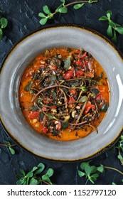 dish of purslane. potulak-edible useful weed. stalks of purslane stewed with tomatoes. Turkish, Greek, Mexican cuisine