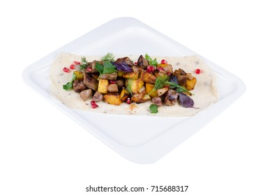Dish from the restaurant menu. Roast with potatoes, meat and greens