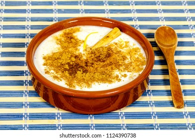 Dish of rice pudding with lemon scratches and with spoon
