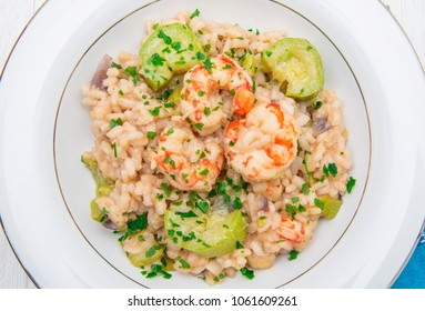 dish with risotto with prawns and zucchini