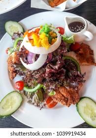 A dish of salad.