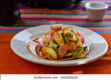 Dish of seafood typical in the coast kitchen named aguachile, the main ingredient is the shrimp, cucumber, onion and chilli
