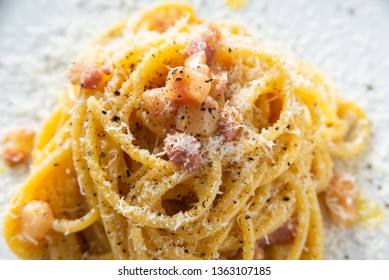 Dish of Spaghetti alla Carbonara, typical italian recipe of pasta with guanciale, egg ad pecorino romano cheese