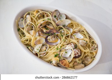 A dish of spaghetti with  clams