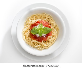 Dish with spaghetti and tomato souce isolated on white background