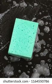 dish sponge on black background