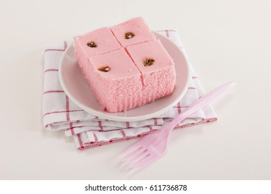 dish of thai sponge cake with dish tower decoration on white background. thai sponge cake or cake Sali in thai language is thai dessert