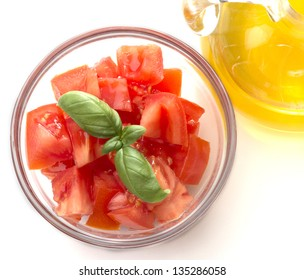 dish with tomatoes and olive oil isolated on white background