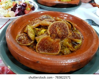 dish with traditional food cooked with figs and beef at a plate called tagine