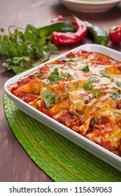 dish with traditional mexican food enchiladas