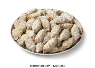 Dish with traditional Moroccan makrout, date cookies, on white background