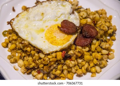 Dish of typical cachupa of the islands of Cape Verde, with chickpeas, fried eggs and chorizo