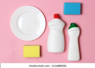 dish washing aids, sponges and a plate on a colored background, top view. Housework, wash the dishes. flatlay