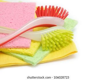 dish washing brushes on  towels isolated on white