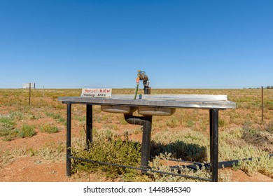 A dish washing station at a camp site in an Australian desert.