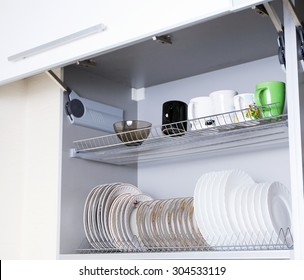 the dishes in the cupboard
