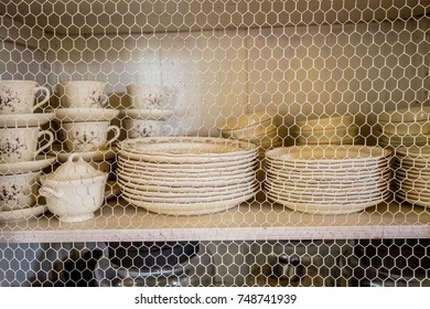 Dishes inside a wire rack.