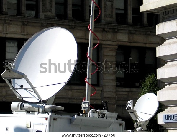 Dishes of Media Vans in Union Square, NYC