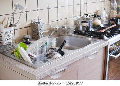 Dishes in the sink - mess in the kitchen