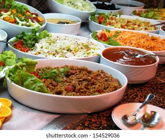 dishes with various salads in buffet restaurant