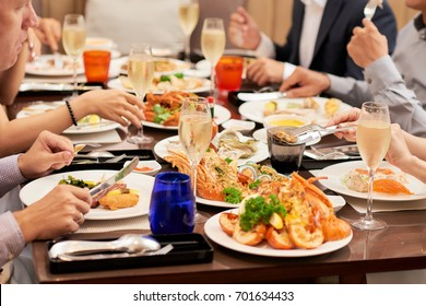 Dishes with various seafood at dinner table, selective focus