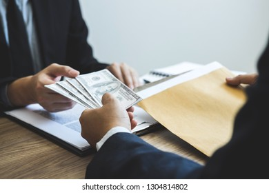 Dishonest cheating in business illegal money, Business man giving bribe money in business people to give success the deal contract of investment, Bribery and corruption concept.
