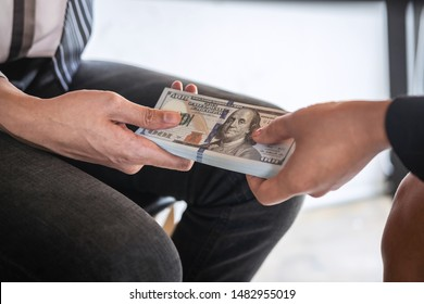 Dishonest cheating in business illegal money, Businessman receive bribe money under table to business people to give success the deal contract of investment, Bribery and corruption concept.