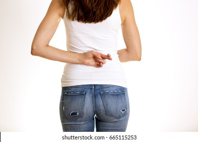 Dishonest woman telling lies, lying female holding fingers crossed behind her back