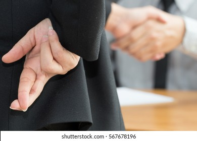Dishonesty, Business fraud concept, Businessman showing fingers crossed