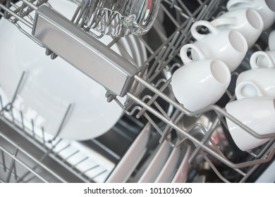 Dishwasher inside with clean dishes.