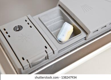 Dishwasher with tab