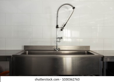 Dishwashing area in  the kitchen of  a restaurant  or hotel