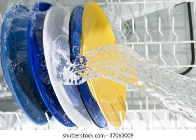 Dish-washing machine and plate. Splashing water