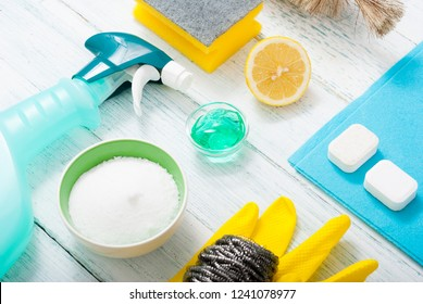dishwashing products on white wood table