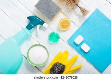 dishwashing products on white wood table