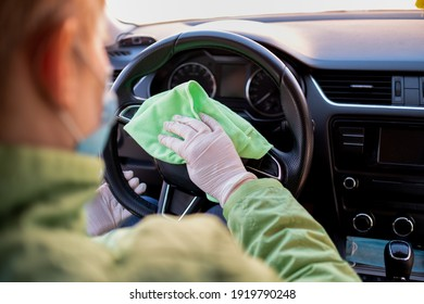 disinfecting the inside of a car with antibacterial wet wipes