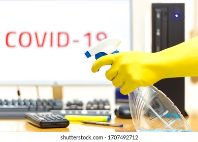 Disinfecting of an office with spray and glove to prevent COVID-19 disease