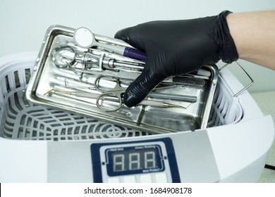Disinfection of a dental instrument. Ultrasound sterilization of a medical instrument. Disinfection in a medical center, hospital, office. Patient care. The best care for a medical instrument.
