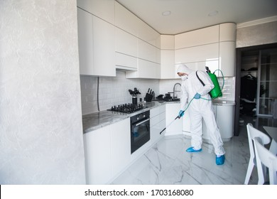 disinfector in a protective suit conducts disinfection in contaminated area. professional disinfection against COVID-19, coronavirus. in clothing protecting from chemical poisoning in the industry