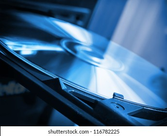 Disk in dvd-rom in blue colors